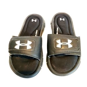 Under Armour kids black cushion foam lined slides